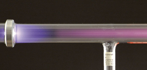 Discharge tube, canal rays