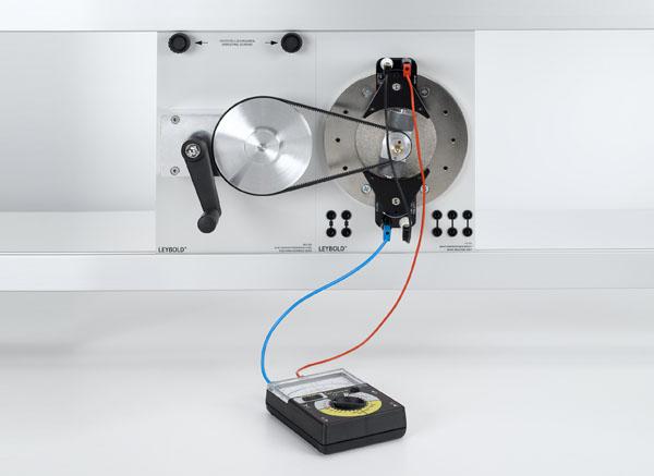 Generating AC voltage using a revolving-field generator and a stationary-field generator