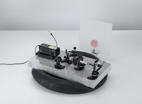 Determining the wavelength of the light of an He-Ne laser using a Michelson interferometer